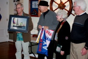 Tony Lawrence presenting Rich Gilbert framed photo of Punk Dolphin