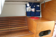 Galley & settee--port. Note bruynzeel plywood bulkhead